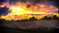 POV footage of driving on highway at spectacular summer sunset Stock Footage