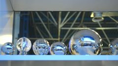 Silver Steel Balls of Different Sizes Placed in a Row on Shelf Stock Footage