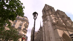 Paris' Notre Dame seen from a low angle perspective Stock Footage