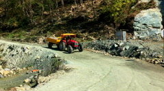 NEPAL –  MARCH 18 2016: Tractor rides on a mountain road. Himalayas HD video. Stock Footage