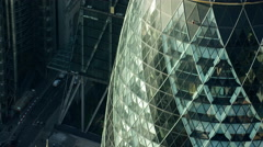 Aerial close up view of the Gherkin building City of London UK Stock Footage