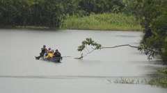 Ecotourism via dugout canoe Stock Footage