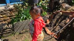 NEPAL –  MARCH 18 2016: Asian girl in Nepal village HD video. Stock Footage