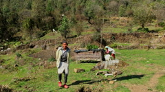 NEPAL –  MARCH 18 2016: Mountain HD video. Farm village: peoples animals Stock Footage