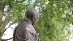 Statue of Mahatma Gandhi on Parliament Square, London Stock Footage