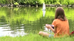 Girl with remote controlled boat Stock Footage