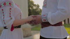 Woman villager in a traditional participates in a traditional Romanian wedding Stock Footage