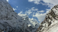 Mountain Himalayas snow peak couds sky Valley ravine nature HD video background - stock footage