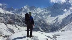 Hiker stay Annapurna mountain valley. Snow peak Nepal HD video background Stock Footage