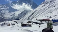 Hiker walking Annapurna Base Camp valley. Mountain snow peak Nepal HD video - stock footage