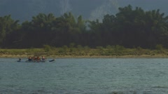 Tourist rafts are sailing over the Li river at a beautiful sunset Stock Footage