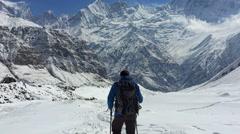 Hiker walking in Annapurna valley. Mountain snow peak Nepal Himalayas HD video - stock footage