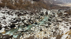 Mountain river flowing Himalayas Nepal. Water in rocks. Snow fog nature hd video Stock Footage