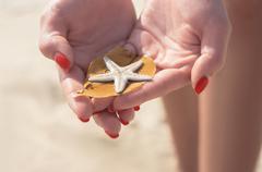 Sea star in hand Stock Photos