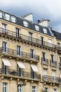 Old residential building front, Paris. - stock photo