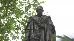 Disraeli (1st Earl of Beaconsfield) – statue on Parliament Square in London Stock Footage