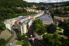 People walk on streets during Karlovy Vary international film festival - stock photo