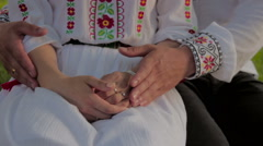 woman villager in a traditional participates in a traditional Romanian wedding - stock footage