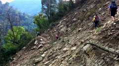 Hikers with backpack cross mountain steep road. Himalayas Nepal travel HD video Stock Footage