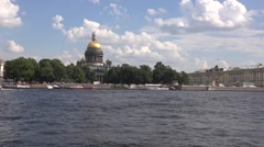 The Saint Isaac's cathedral and boat piers alnong Admiralteyskaya Embankment Stock Footage