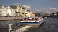 The boat rides along the Fontanka River heading southwards Stock Footage