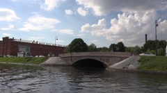 Riding along the Kronverksky Canal near the Artillery Museum Stock Footage