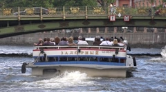 Boat riding under the Saint Pantelymon's Bridge across the Fontanka River Stock Footage