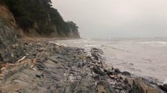 Sea waves on wild stony coast Stock Footage