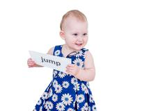 Little girl holding a card Stock Photos