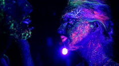 The tenderness of the couple ultraviolet light. Fluorescent powder. Stock Footage