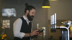 4K Friendly bartender serving & chatting with customer in trendy bar Stock Footage