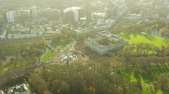 Aerial view of Buckingham Palace and St James Park London England Stock Footage