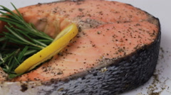 Rotating baked salmon steak Stock Footage