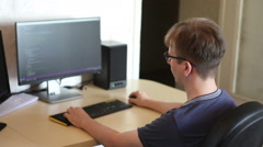 Student programmer work on the software code at home sitting at the computer. Stock Footage