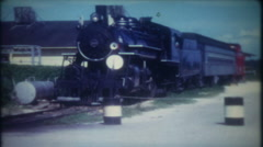 3424 train slows down to roll through small town-vintage film home movie Stock Footage
