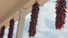 Chile Ristras Hang from White Rafters Stock Footage