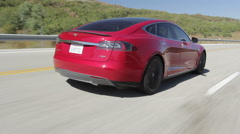 Model S Rear Driving w Pass Stock Footage