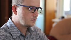 man with glasses working at the computer and t tired eyes - stock footage