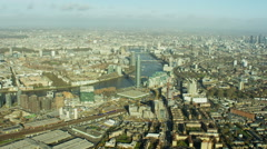 Aerial view River Thames and City of London UK Stock Footage
