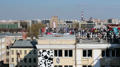 Crowd Of People On The Top Of The Roof Stock Footage