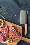Fresh raw meat on chopping board with knife. top-view Stock Photos