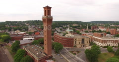 Aerial flying around a clock tower in a small town, 4K Stock Footage