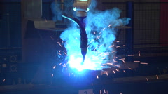 Steel plant metal and iron robotic welding arm metal construction Stock Footage