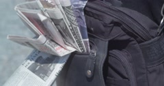 Military postman with a bag full of newspapers. Stock Footage