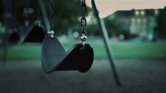 Empty swing in park during evening hours with no children 4k - stock footage