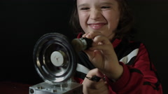 4k shot of a cute child working in laboratory- Exploring a Gear spinning Stock Footage