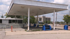 Old abandoned independent gas station after bankruptcy in recession. - stock footage