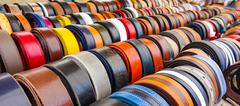 Colorful leather belts on a market - stock photo