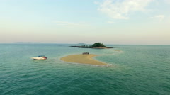 A group of people on a small desert island. Aerial video, the drone moves away. - stock footage