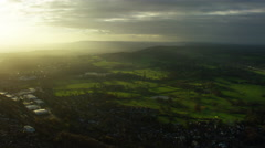 Aerial view of countryside outside City of London UK Stock Footage